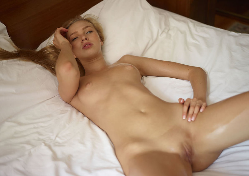 Young girl nude in bed