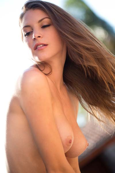 Takes Off Her Top In Warm Sunlight