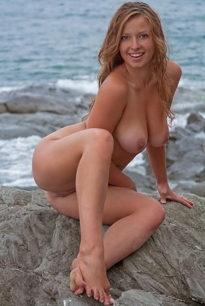 Aurelia in Horny blonde Aurelia on the rocks from Domai