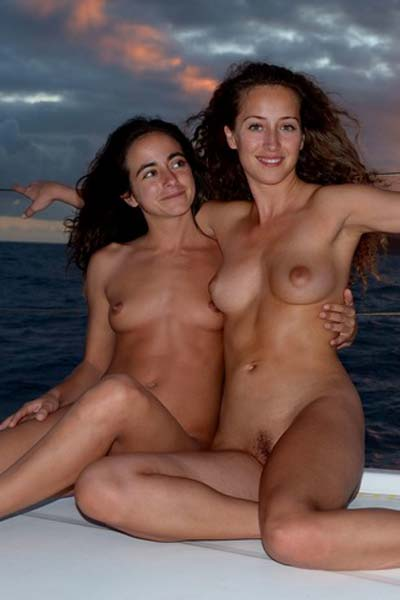 Two girls nude on a sailing boat