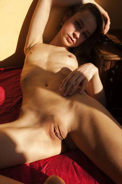 Naughty naked Tigra on the red bed