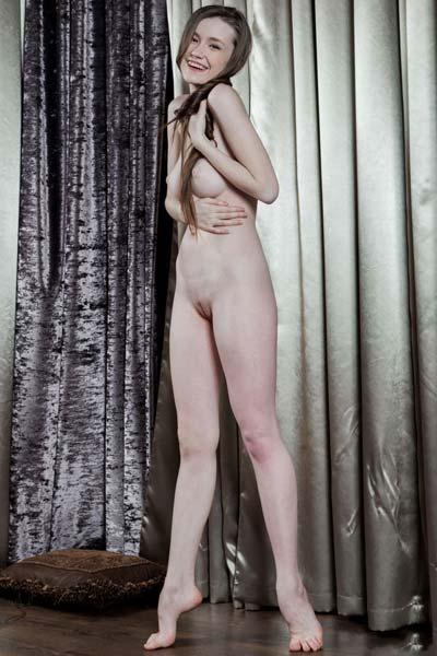 Pretty brunette Emily Bloom exposes her tasty body