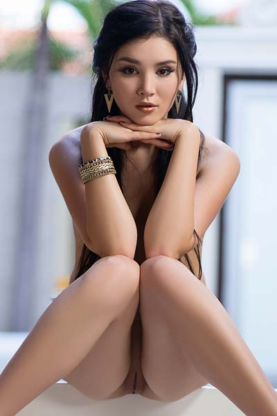 Playboy Ukrainian black haired beauty Malena poses for the camera