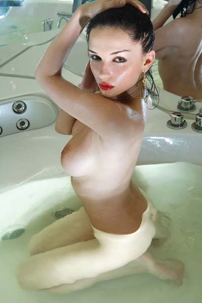 Have a sneak peek of busty Jenya D posing in the bath tub