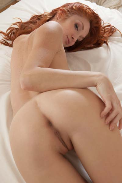 Naughty redhead Michelle H exposes her attributes on the bed