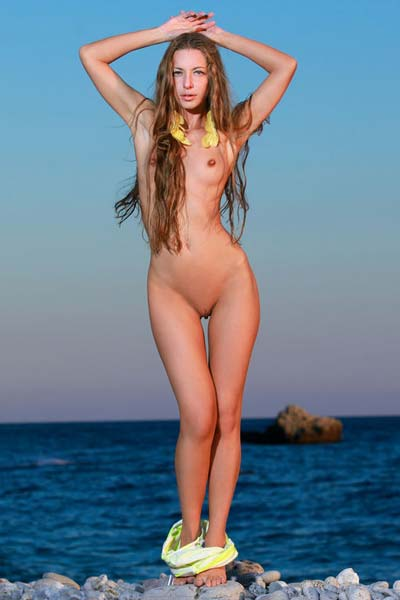 Long haired babe Sofiya poses naked by the sea