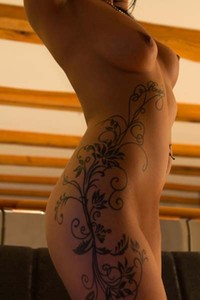 Tattooed Alta B poses eroticaly and plays with her beaver