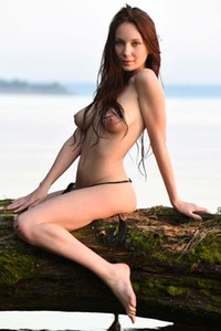 Seductive Eva M strips and teases sensually by the lake