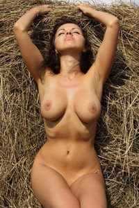 Exotic busty Mila is naked in a haystack