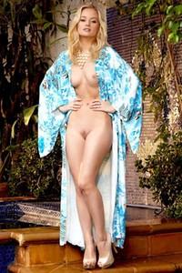 Blonde stunner Gabi dips her naked feet in the pool