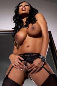 Priya Rai opens her corsett revealing her big breasts