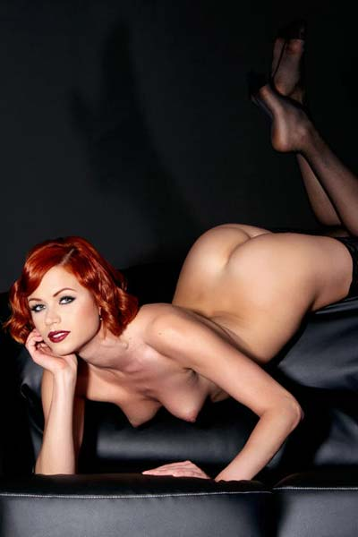 Sensual redhead Kami Strips on the Couch