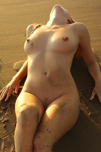 Busty Hayley naked on the beach