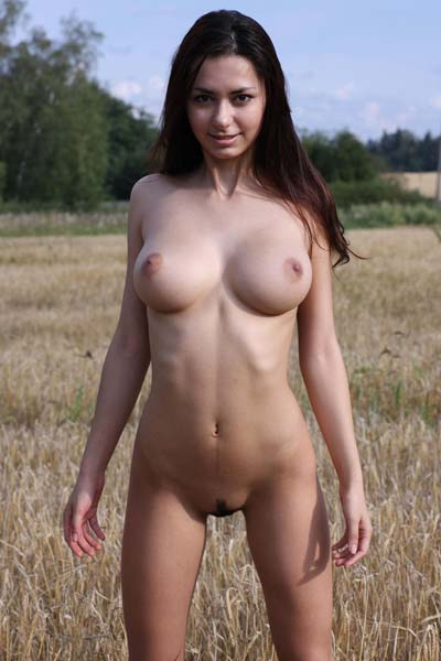 Busty and sexy Helga outdoors