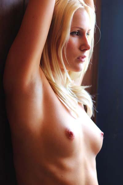 Seductive Ashley poses eroticaly