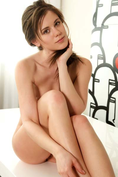 Irresistible brunette Caprice A strips and poses eroticaly
