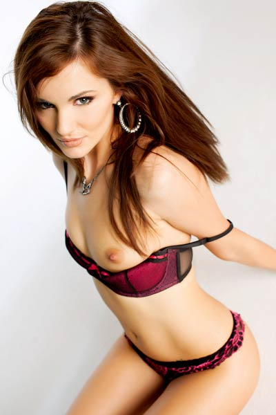 Irresistible brunette with sexy long legs Lily Carter strips and poses eroticaly
