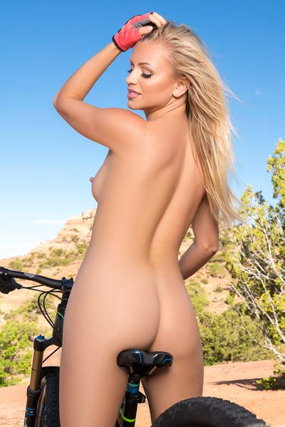 Exotic natural blonde Blanca Brooke exposes her delicious curves on the mountain
