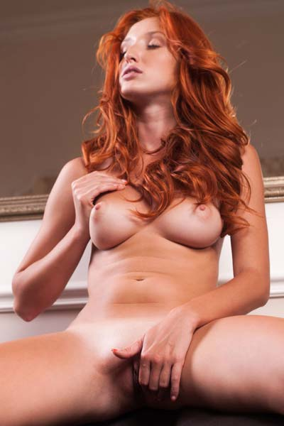 Beautiful redhead Foxy T loves to tease