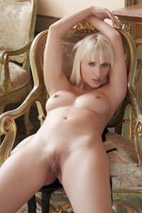 Stunning blonde Colette gets naked in front of the mirror