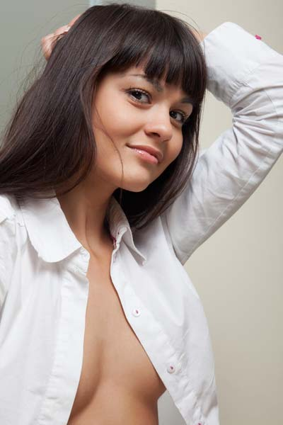 Elegant brunette beauty Shereen unbuttons her white shirt