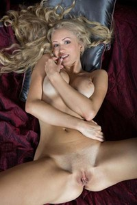 Busty blonde Henrietta flashes her pink pussy shamelessly