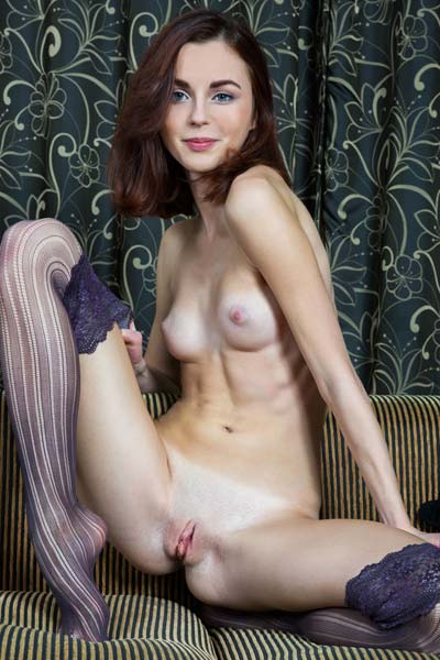 Seductive Aurmi has only a pair of tight stockings on her