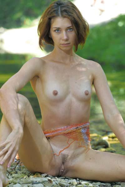 Oda dips her perky body in the river