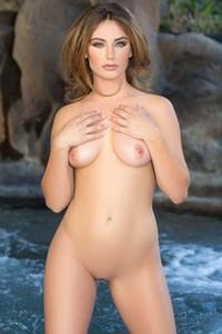 Playboy Lauren Love bares her slender body and teases erotically
