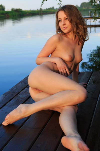 Nikia A showcases her sexy body on the docks