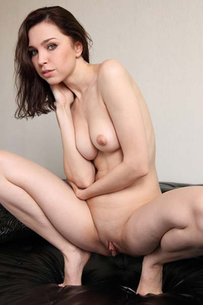 Lovely brunette Oliviana gets completely naked for the camera