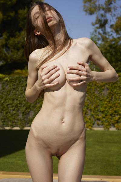 Aya Beshen bathes in sun rays with no clothes on