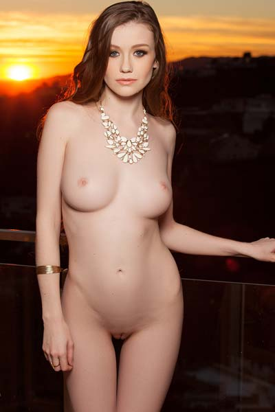Brunette beauty Emily Bloom displays her gorgeous curvy body on the stairs