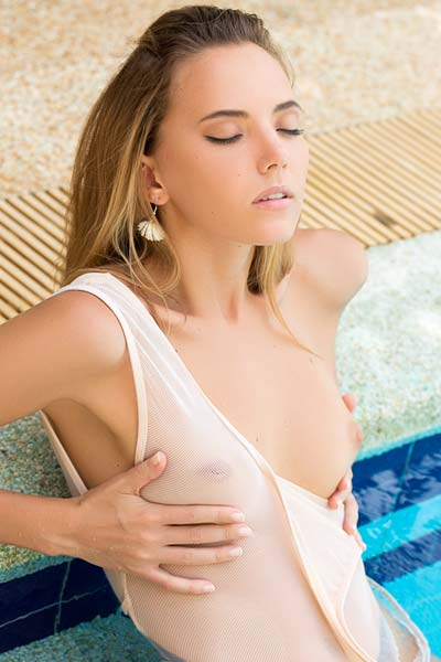 Young Katya Clover wet in the pool