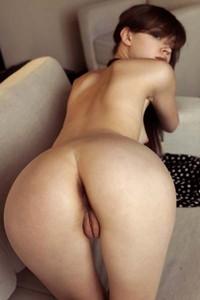 Sexy brunette Kitana A poses nude on the sofa