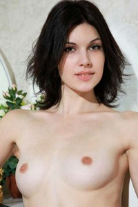 Elizabet bares her petite body and poses erotically