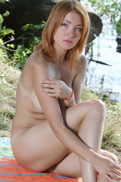 Magnificent busty blonde Kika steps in the nude by the river