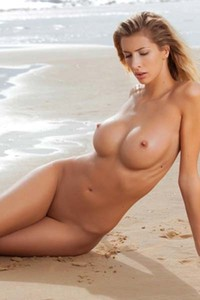 Stunning Claudia undresses and poses on the beach