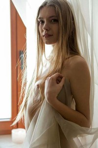 Fantastic babe Sigrid steps in the nude and poses sensually