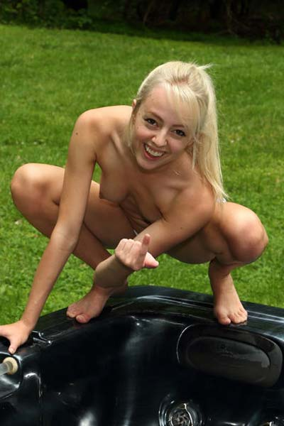 Naked Sierra Nevadah spreads her legs outdoors