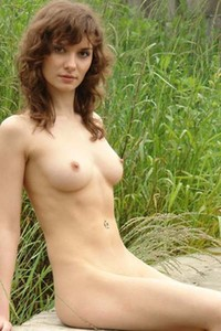Fabulous brunette Jini steps in the nude outdoors