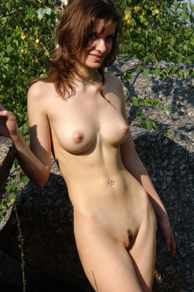 Amazing brunette Jini exposes her amazing assets outdoors