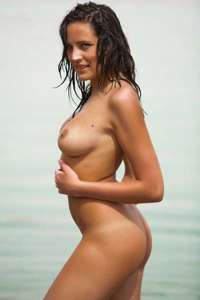 Saylor presents her soft and smooth assets by the sea