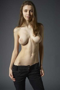 Busty Milla undresses and teases sensually