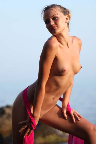 Perky beauty April bares her sexy body on the beach