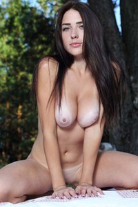 Fabulous busty babe Niemira strips and poses in the woods