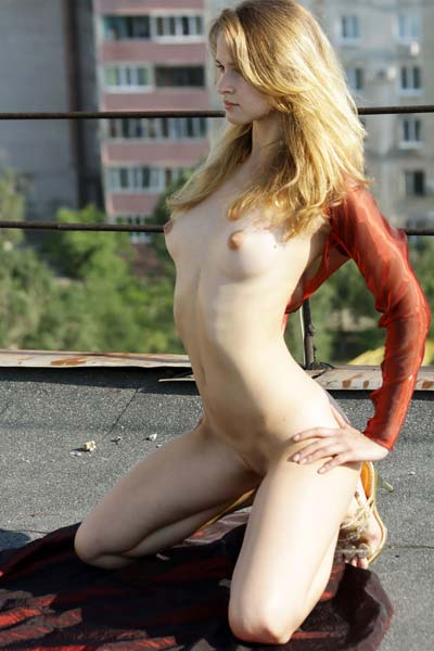 Fabulous Angela strips and teases on a rooftop