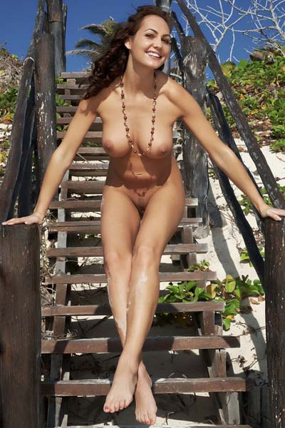 Outstanding Gabriela shows off her big boobs on the stairs