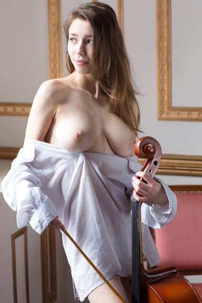 Young and busty Milla poses nude shamelessly