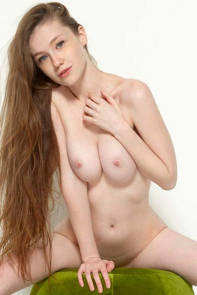 Stunner Emily Bloom completely naked sharing her pale skin and big boobs
